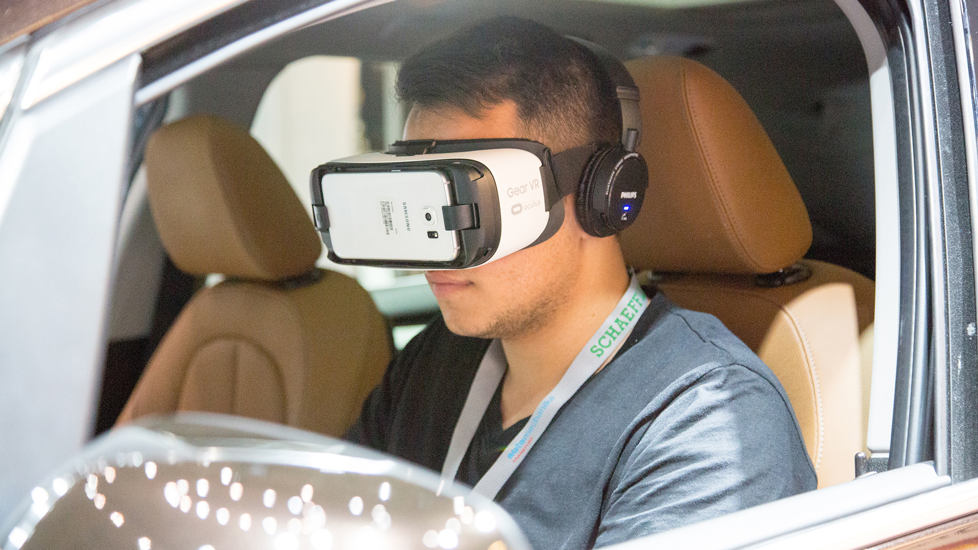 Person with VR glasses in the driver's seat of a car
